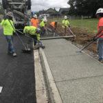 Fine grain evolution pervious concrete sidewalk, sitework